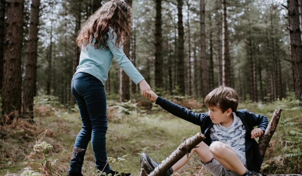 girl helping up boy